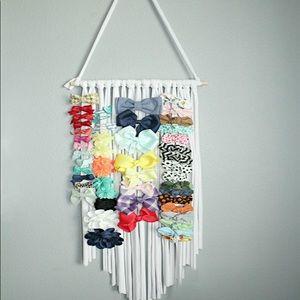 Brand New Hanging Bow Storage Organizer
